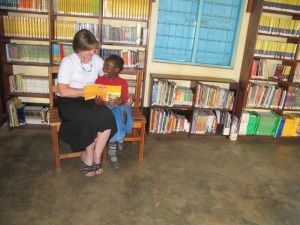 Reading in the Kasiisi Library with Sandra