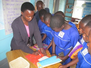 Josephine Teaches Students How to Sign Out Books